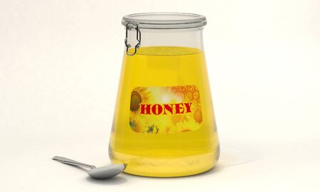 Jar of honey with a spoon.