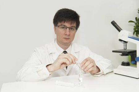 doctor with a microscope