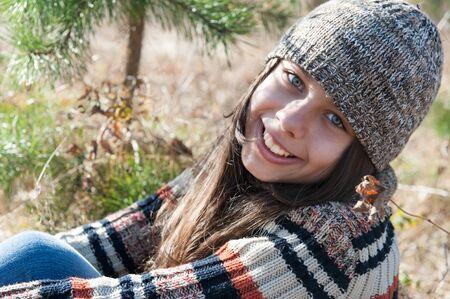 Teen girl walks in the autumn forest