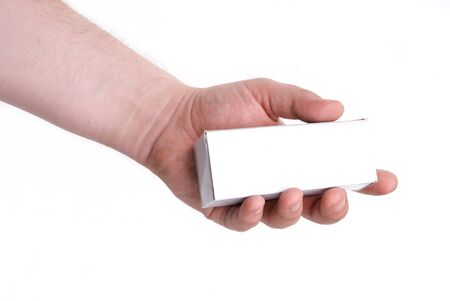 White small box in a mans hand