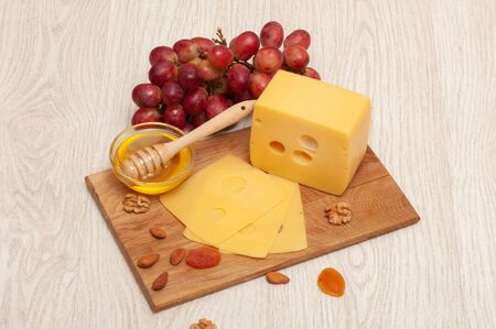 different types of cheese on a wooden board 스톡 콘텐츠