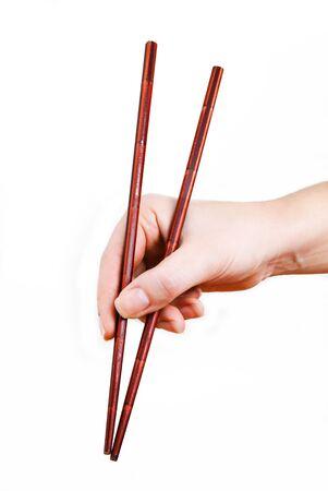 Bamboo Japanese chopsticks in a female hand Foto de archivo