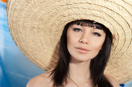 Brunette girl in a mexican hat