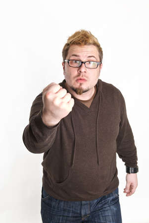 A man with glasses threatens with his fist