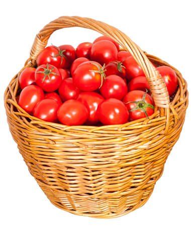 Tomatoes in a basket on a white background Stok Fotoğraf