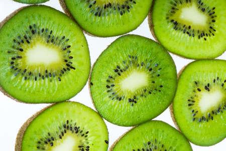 Round slices of kiwi isolated on white background