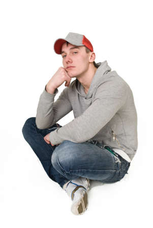 Young man in a gray sweatshirt on a white background Stock fotó