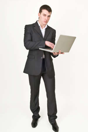 Young man in business suit with laptop Stock fotó