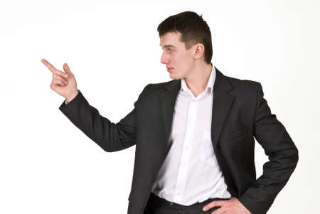 Young man in business suit points finger Stock fotó