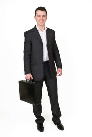 Young man in business suit with case Stock fotó