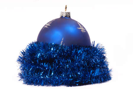 Blue Christmas tinsel with Christmas balls on a white background Stock fotó