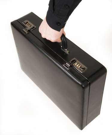 Black briefcase in a mans hand on a white background