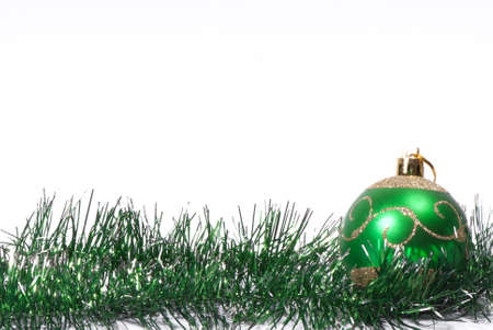 green Christmas tinsel with Christmas balls on a white background Stock fotó