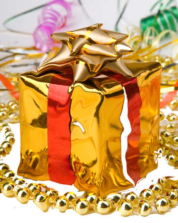 New Years gift wrapped in gold paper