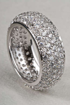 White gold ring with diamonds on a white background