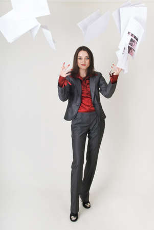 Young business woman in business clothes with documents is angry