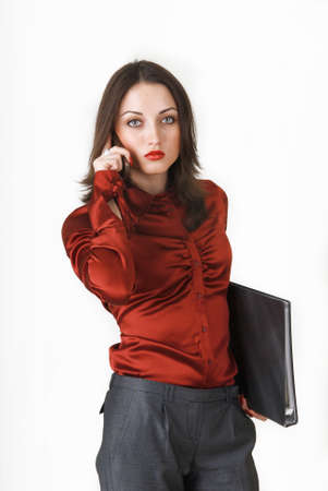 Young business woman in business clothes with a folder