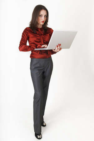 Young business woman in business clothes with laptop