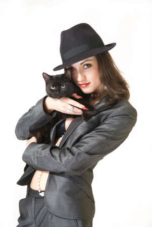 Young business woman in business clothes with a black cat on a white background Stock fotó