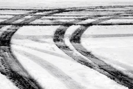 Tire tracks in de sneeuw Stockfoto
