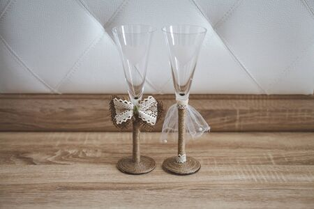 Pair of wedding champagne glasses. The decor of the bride and groom