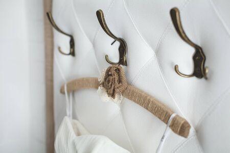 Elegant white wedding dress on a hanger 免版税图像