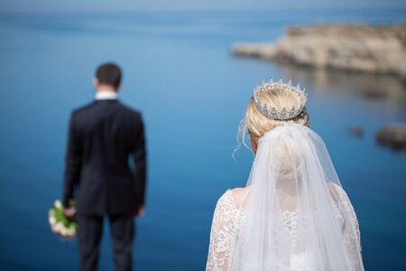 meeting the bride and groom on the background of the sea