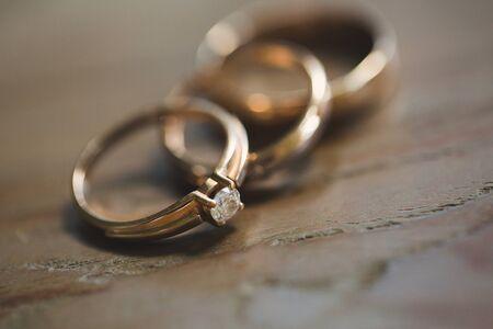 three wedding rings on a wooden background 免版税图像