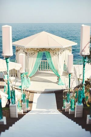 Wedding arch in blue color on the beach.