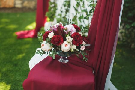 Beautiful wedding ceremony in the Park in the color of Marsala