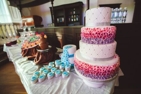 Wedding cake with cupcakes at the exhibition