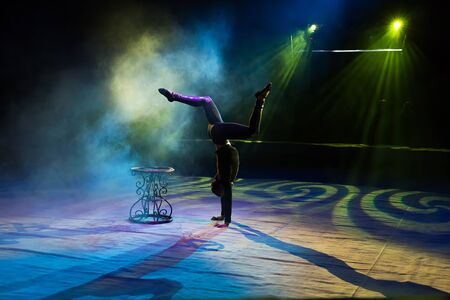 Acrobat performs a difficult trick in the circus