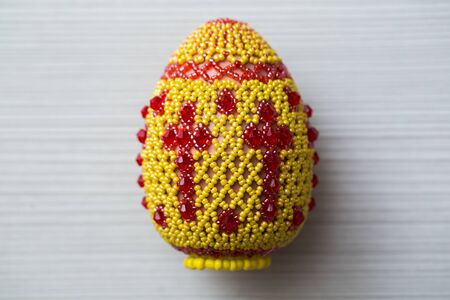 Eggs decorated with small beads. Hand made things.