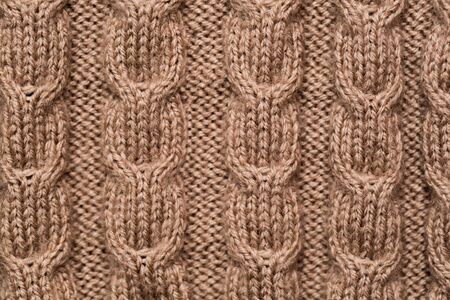 knitted fabric background texture gold. Knitted ornament