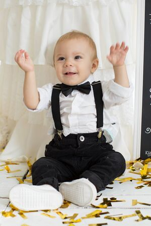 A boy in a Tux at a party in honor of the birthday. Standard-Bild