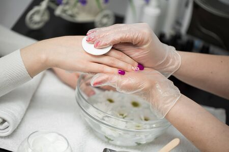 Woman is getting manicure in a beauty salon. Hands Spa. Manicure concept