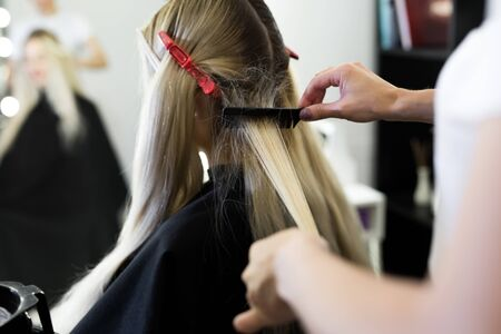 Process of dyeing hair at beauty salon