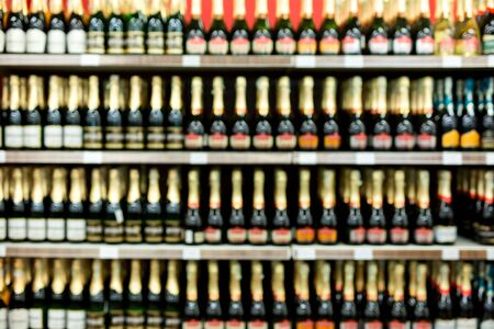 Abstract blurred image of alcohol store in supermarket.