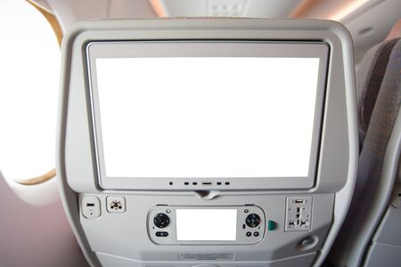 Aircraft monitor in passenger seat isolated on white background.