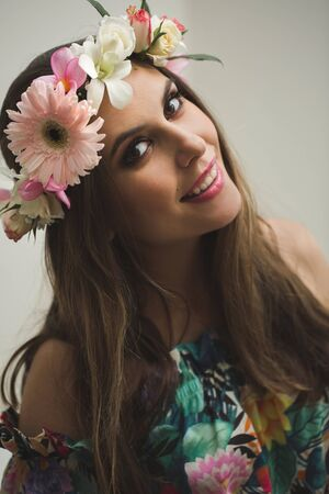 Beautiful woman with flower wreath.