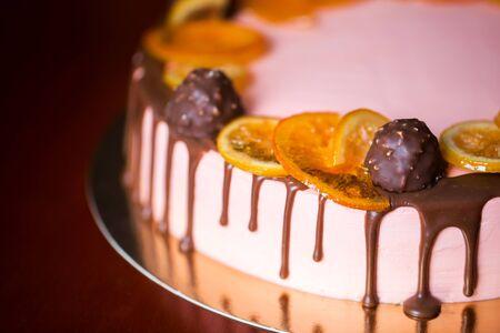 Cake with dried fruits, orange, lemon and chocolates