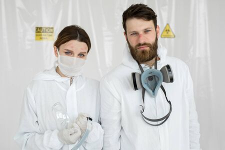 Exhausted doctors or nurses taking of protective mask uniform. Coronavirus Covid-19 outbrek. Mental state of medical professional. Overworked health workers with tears in his eyes