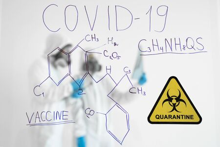 In a Secure High Level Laboratory Scientists in a Coverall Conducting a Research. Coronavirus outbreak. Concept of Covid-19 quarantine. Doctor and medical care. Personal Protective Equipment