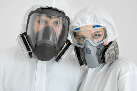 Coronavirus epidemic outbreak. Portrait of doctors in clean suits with protective respirator