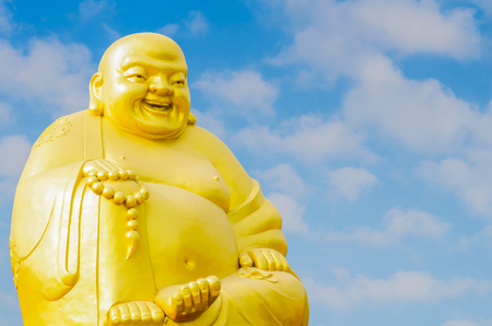 gold Buddha  statue  on a background clear blue sky  photo