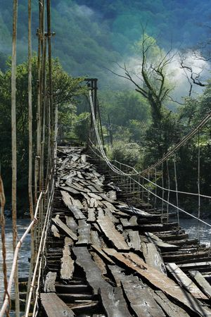 the ancient pass: very old suspension bridge with wooden footstep