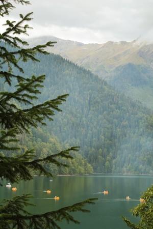 mountain lake with catamarans photo