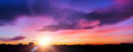 purple sunset:  panoramic view of sunset in a city