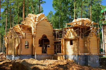 Building of the new log house photo