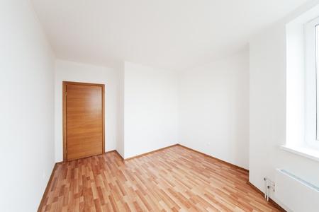 white empty room with door photo